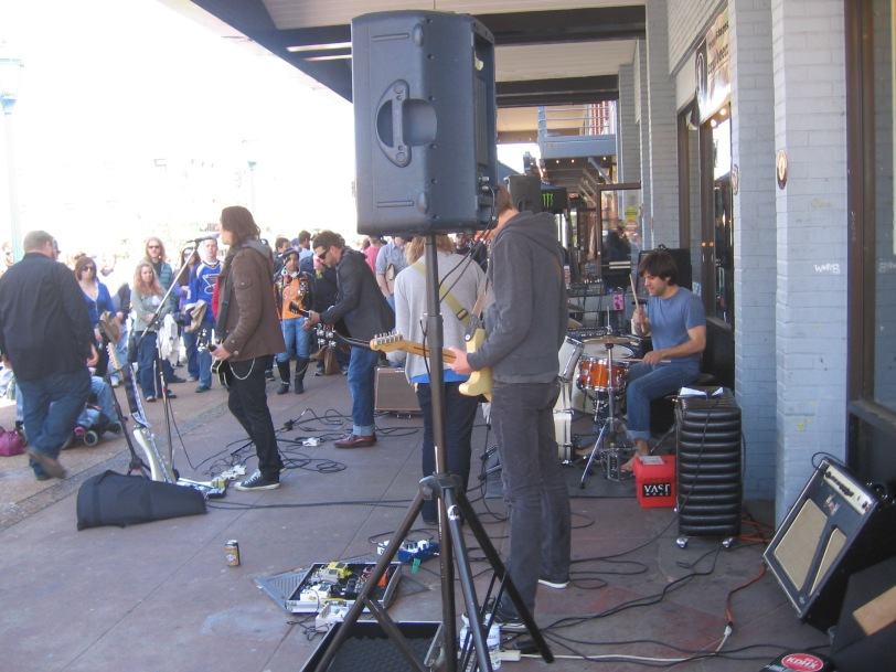 I'll give you a hint; look for the shoeless lazy person sitting down (The Incurables at Vintage Vinyl's Record Store Day)