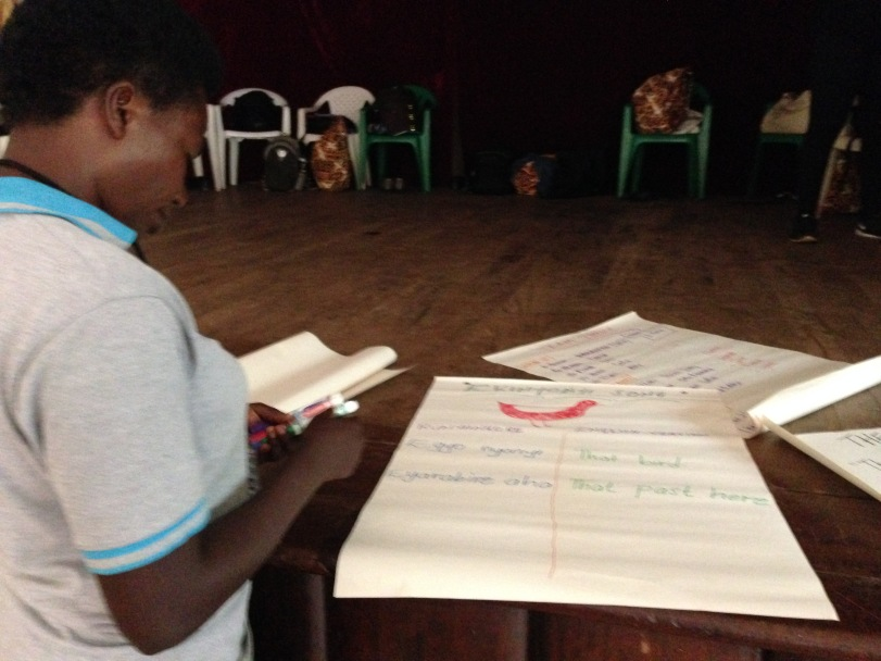 One of my teaching partners, Dorcus, writing out lyrics to a Ugandan song